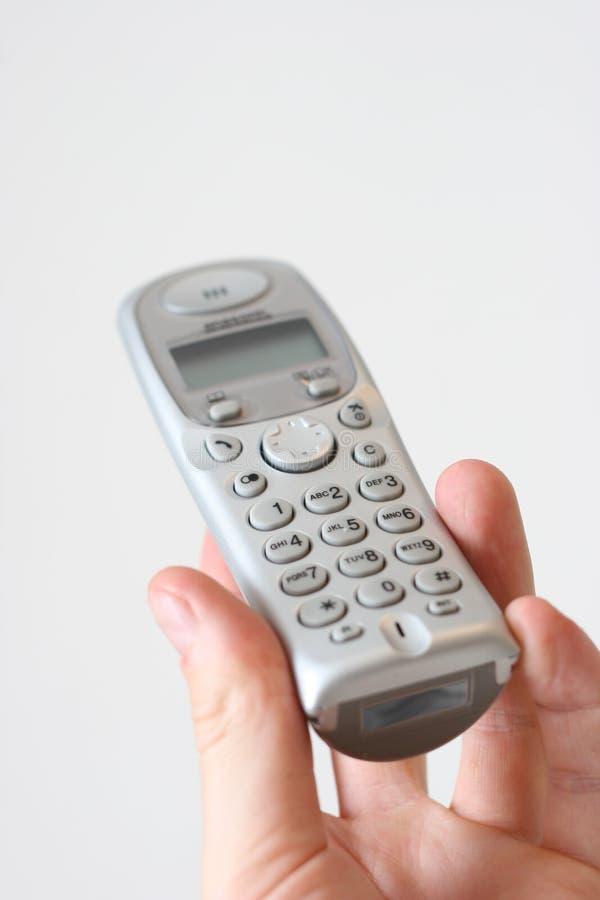 Telefone moderno à disposicão foto de stock