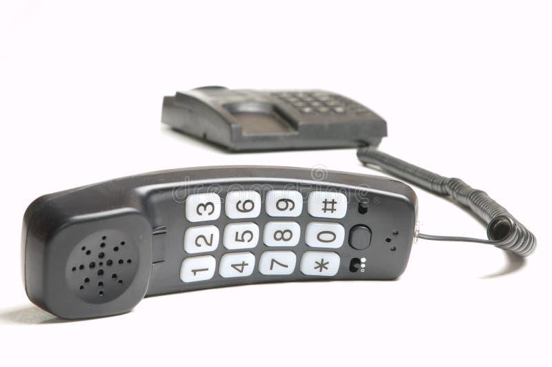 Telefone prendido fotografia de stock