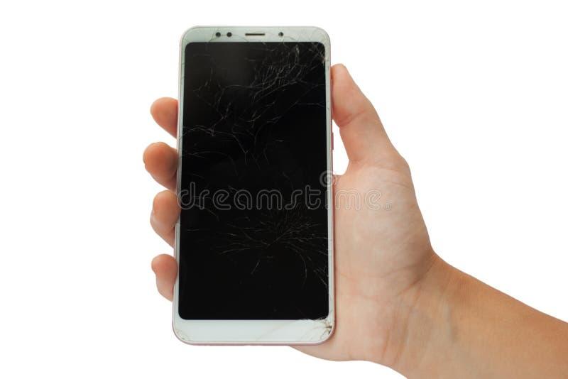 Telefone quebrado branco na mão masculina no fundo branco golpeado, isolado do sensor da tela fotos de stock royalty free