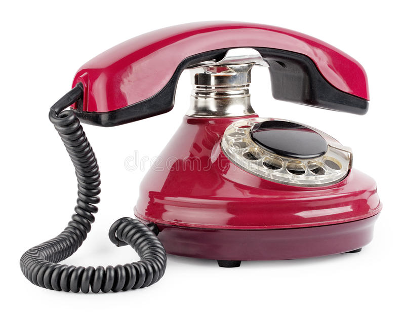 Telefone velho vermelho com disco fotografia de stock