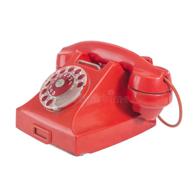 Telefone velho vermelho com o seletor giratório, isolado no fundo branco, SE foto de stock