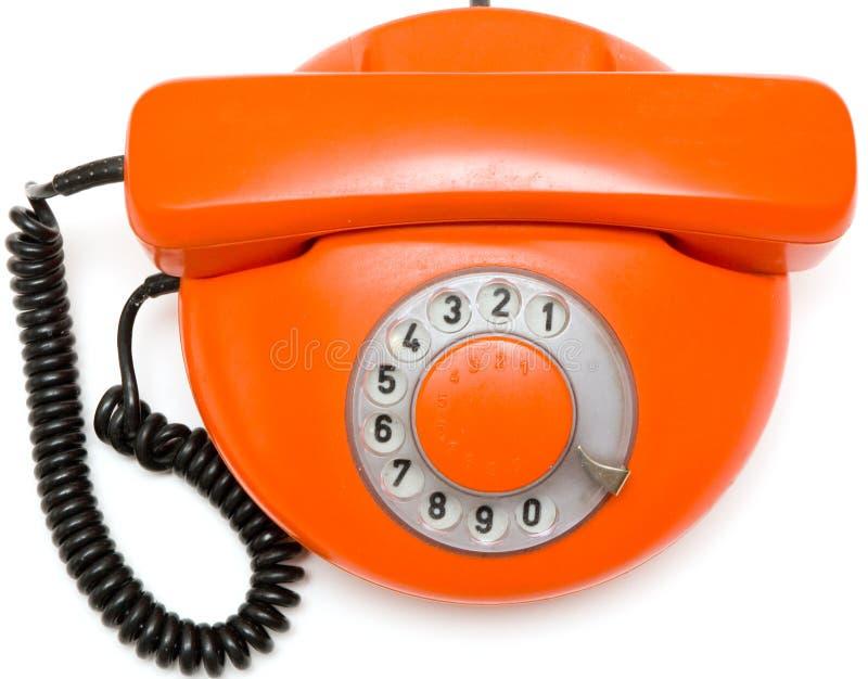 Telefone vermelho velho no fundo branco fotografia de stock