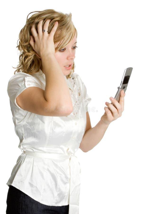 telefonen belastade kvinnan royaltyfria bilder