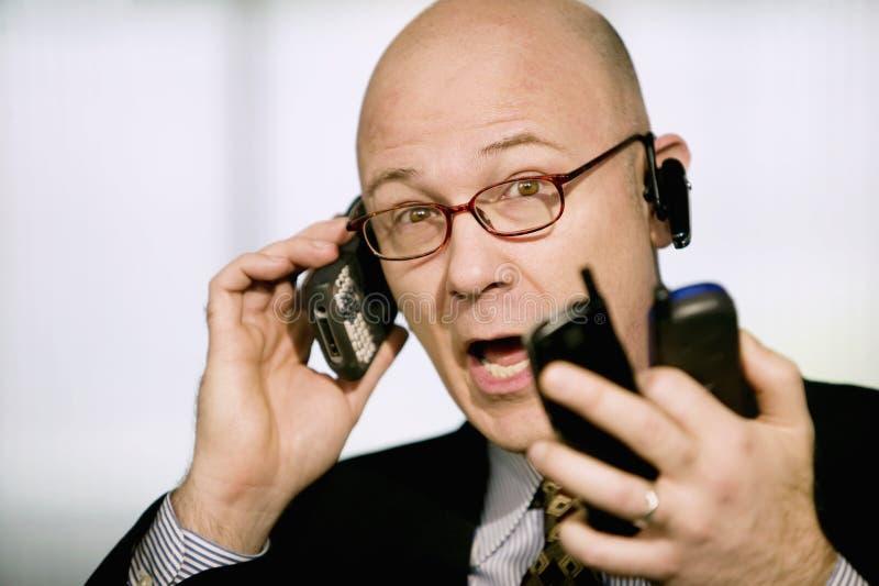 telefoner för affärsmancellmultiple royaltyfri foto