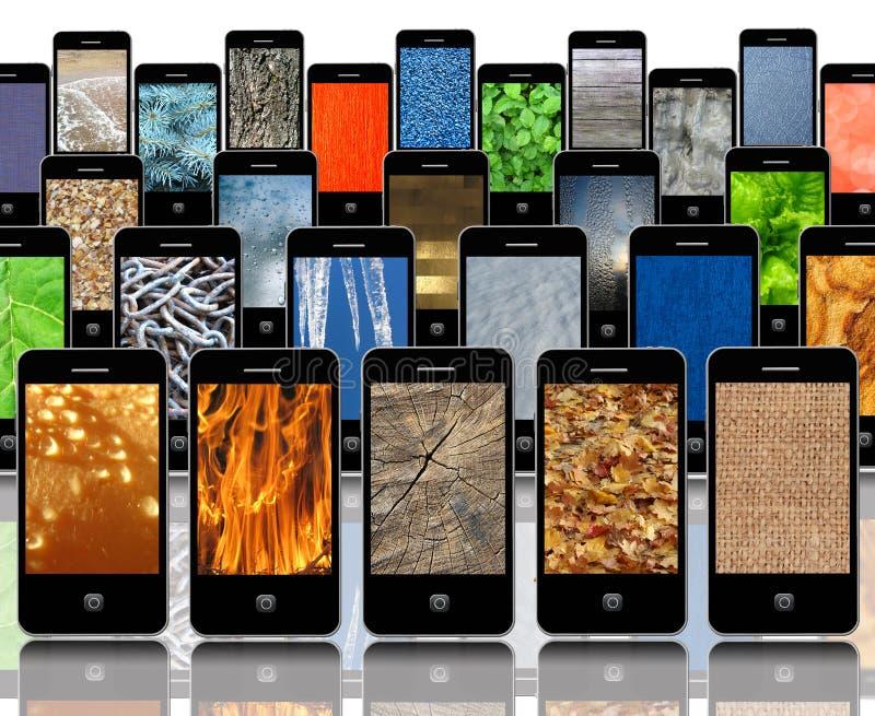 Telefones celulares com texturas abstratas diferentes fotos de stock royalty free