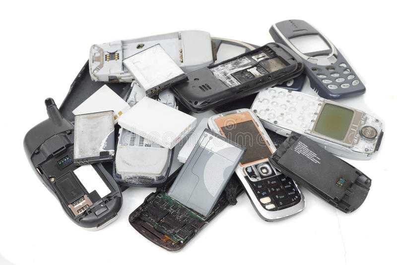 Telefones celulares e bateria velhos fotografia de stock royalty free