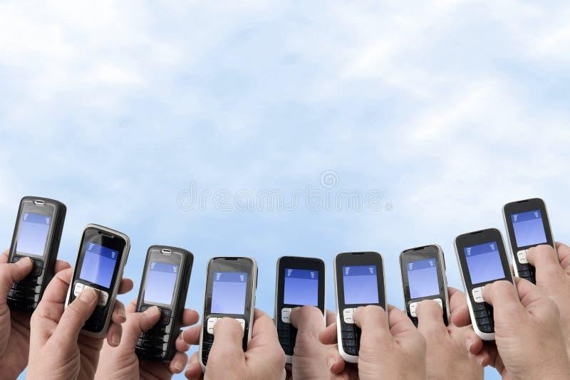 Telefones de Mobil - mãos e telefones imagem de stock royalty free