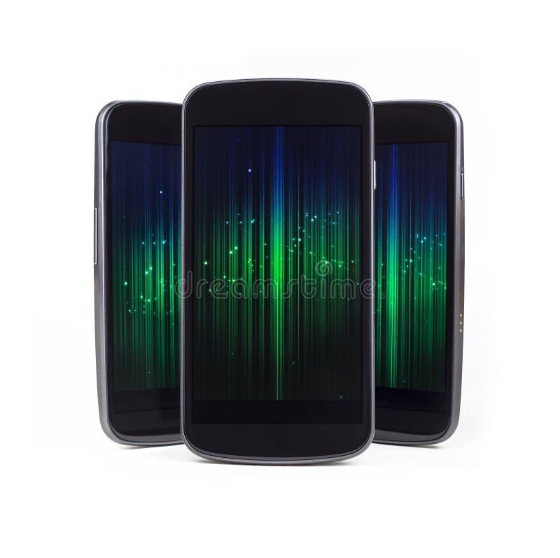 Telefones espertos múltiplos sobre o branco fotografia de stock
