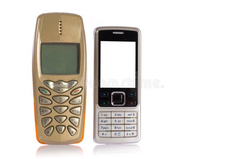 Telefones móveis novos e velhos, melhoramento fotografia de stock
