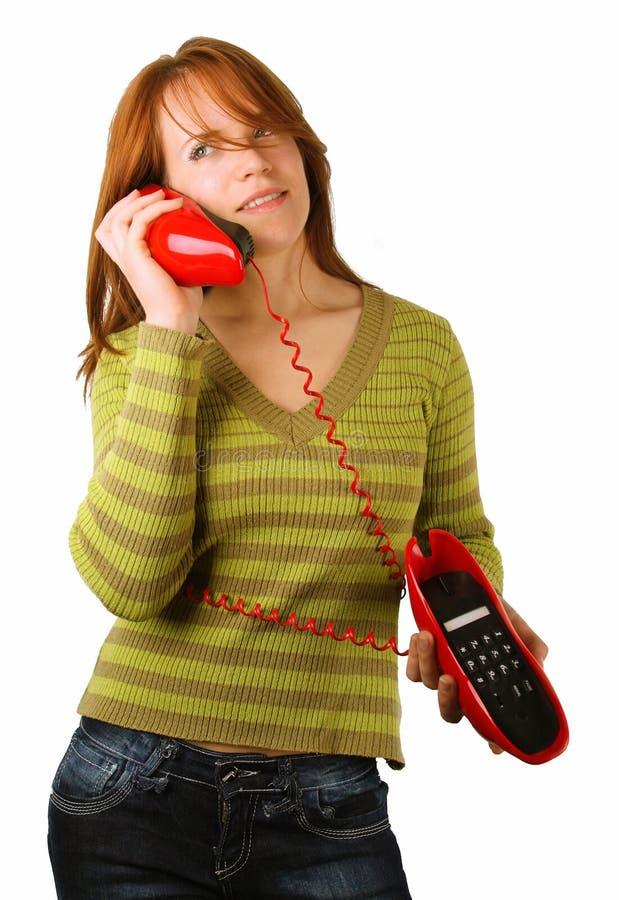 telefoniczna czerwieni kobieta obraz stock
