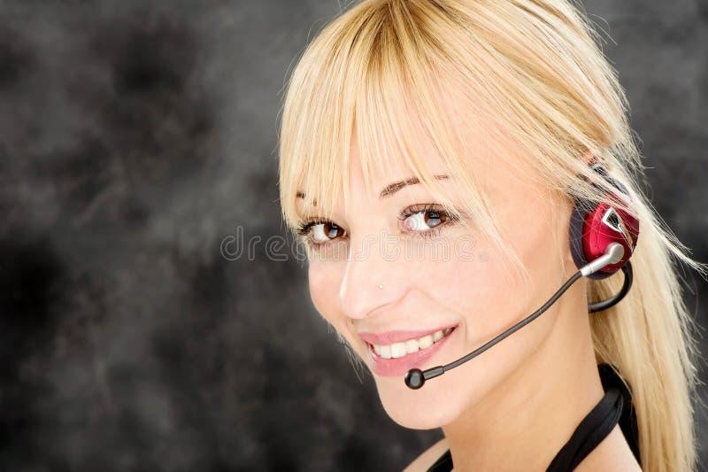 Telefonista c?moda imagen de archivo libre de regalías
