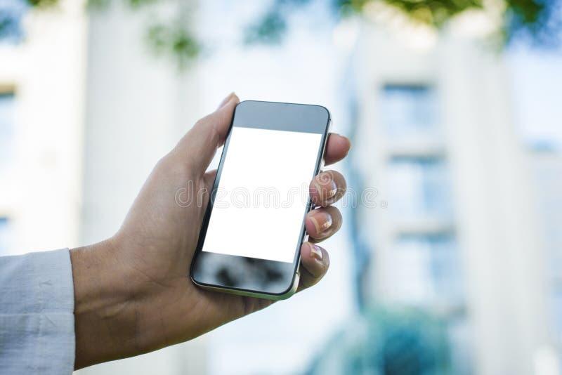 Telefono cellulare commovente immagine stock