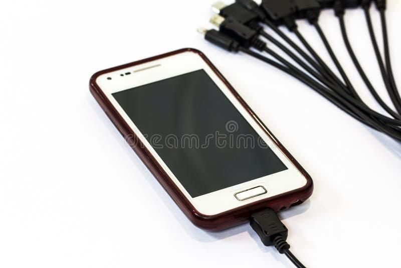 Telefono cellulare di carico fotografia stock libera da diritti
