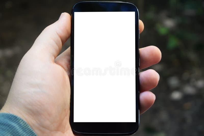 Telefono cellulare a disposizione, posto per la pubblicità, iscrizioni fotografie stock libere da diritti