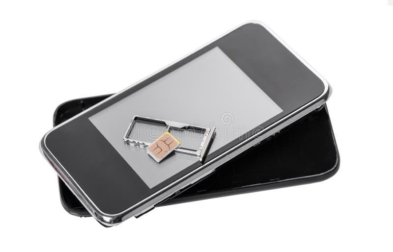 Telefono cellulare e carta SIM immagini stock