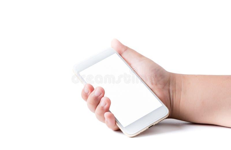 Telefono cellulare in mano del ragazzo con lo schermo attivabile al tatto in bianco bianco immagine stock libera da diritti