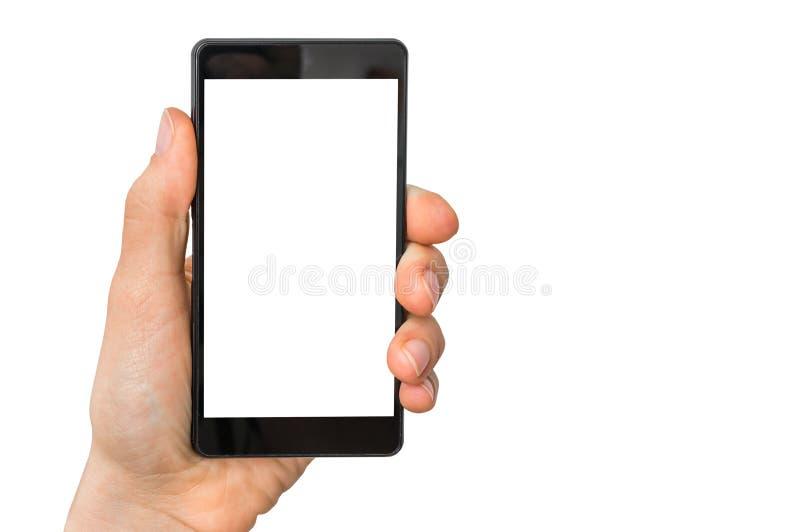 Telefono cellulare mobile con lo schermo bianco in bianco in mano femminile fotografie stock