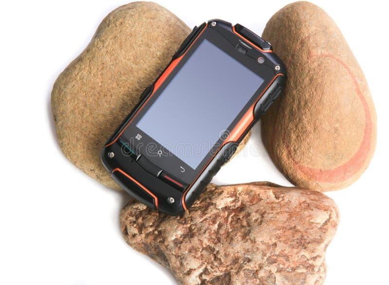 Telefono cellulare nel caso della scossa-prova fotografia stock libera da diritti
