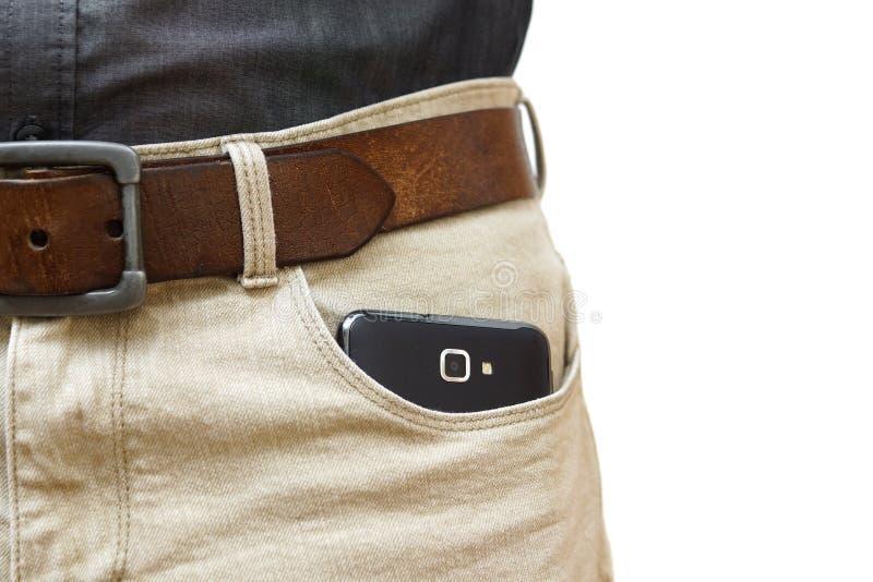 Telefono cellulare in tasca fotografia stock