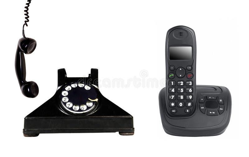 Telefono d'annata e moderno immagine stock