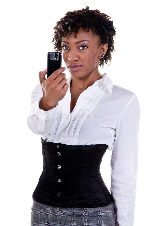 Telefono della macchina fotografica della donna di affari immagini stock libere da diritti