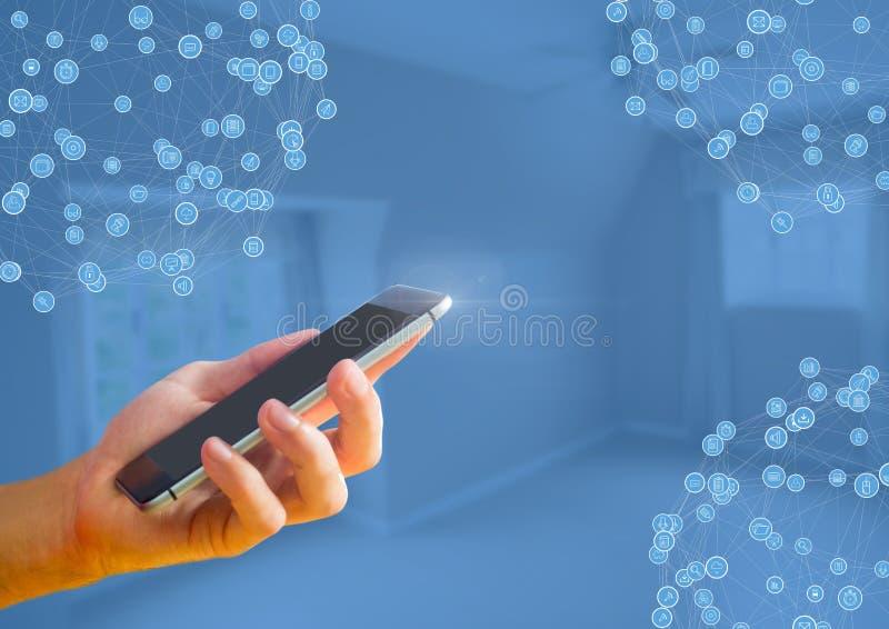 Telefono della tenuta della mano con i connettori immagine stock libera da diritti