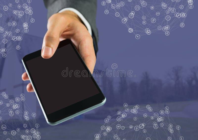 Telefono della tenuta della mano con i connettori fotografia stock