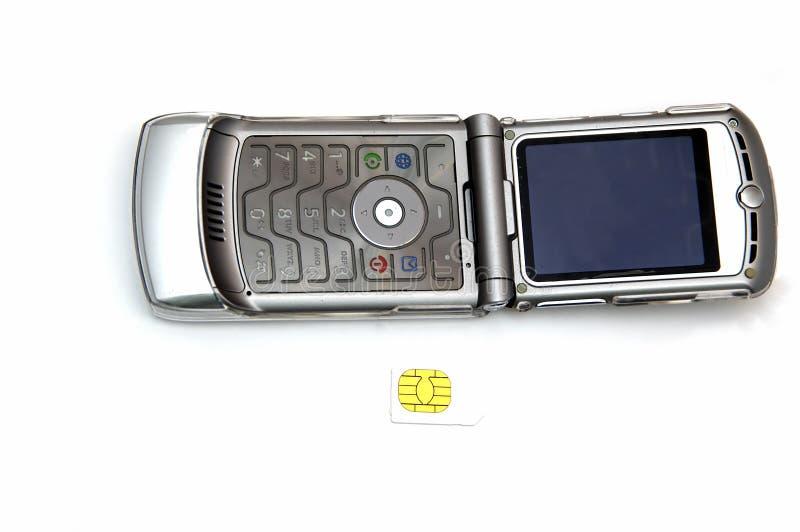 Telefono delle cellule e scheda di Sim fotografia stock