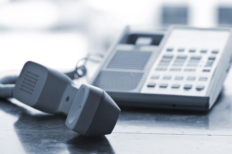 Telefono dello scrittorio fuori dall'amo immagine stock libera da diritti