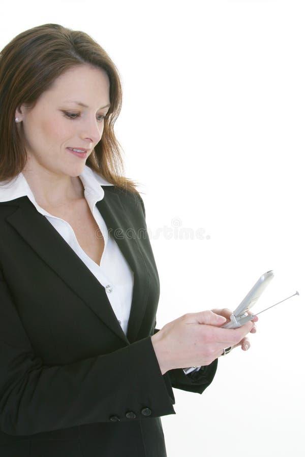 Telefono di composizione delle cellule della donna fotografia stock libera da diritti