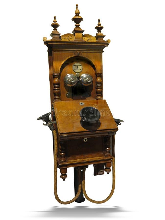 Telefono di legno d'annata antico dall'inizio del secolo 20, isolato su fondo bianco fotografie stock libere da diritti