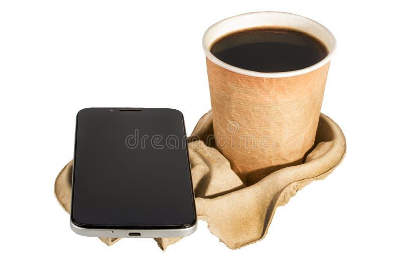 Telefono e caffè sul supporto Isolato fotografia stock libera da diritti