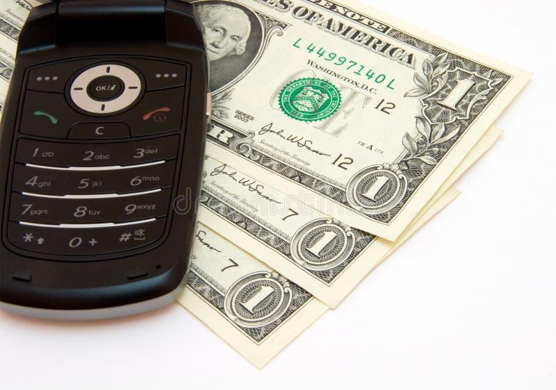 Telefono e dollari fotografia stock