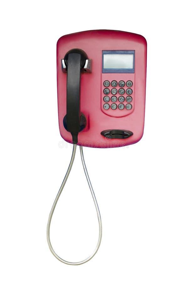 Telefono a gettone rosso del telefono su un fondo isolato bianco fotografie stock libere da diritti