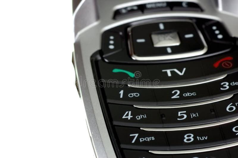 Telefono mobile della TV fotografie stock