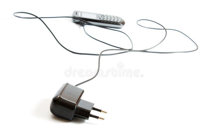 Telefono mobile di carico immagine stock libera da diritti