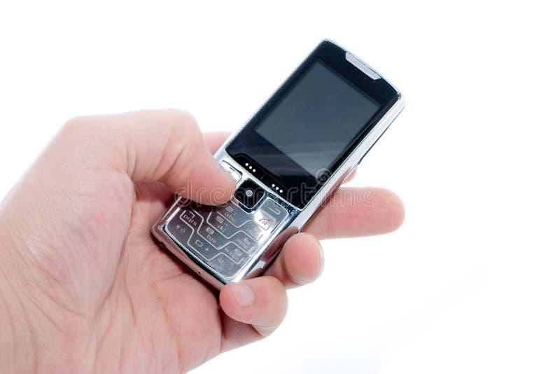 Telefono mobile a disposizione immagini stock