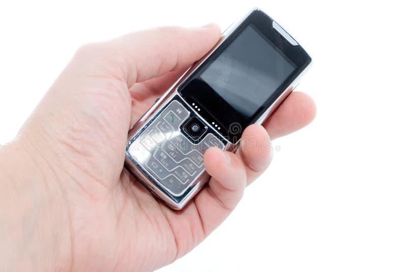 Telefono mobile a disposizione fotografie stock libere da diritti