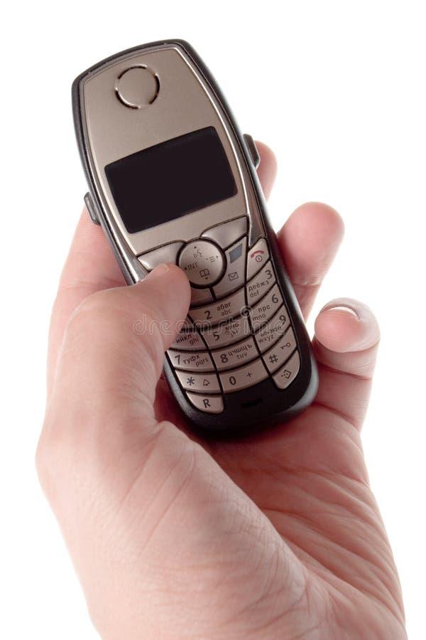 Telefono mobile a disposizione immagine stock