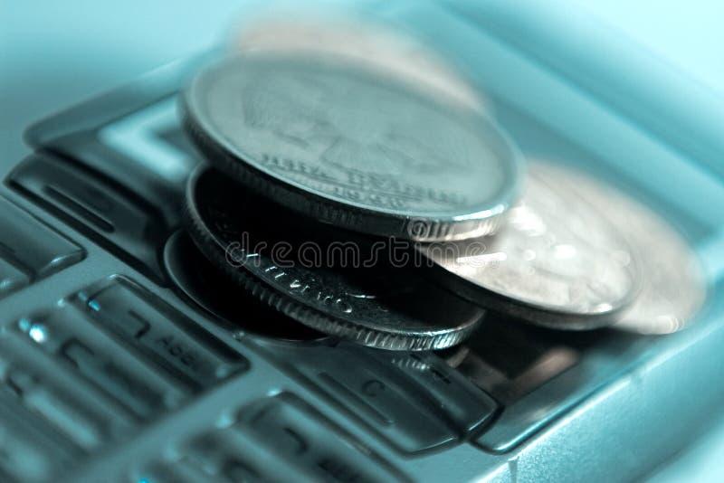 Telefono mobile e soldi fotografie stock