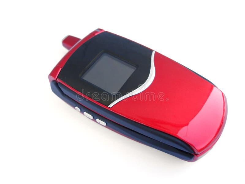 Telefono mobile rosso sopra una priorità bassa bianca fotografie stock