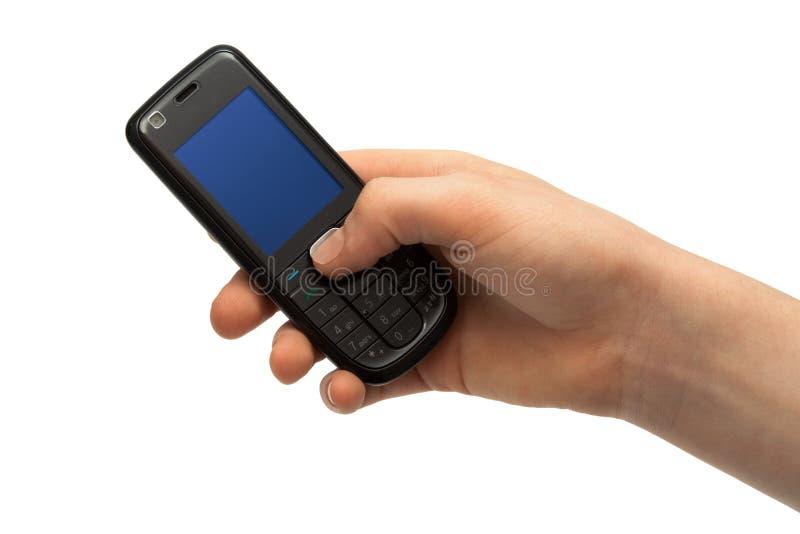 Telefono mobile in una mano fotografia stock
