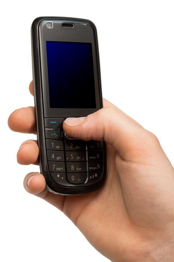 Telefono mobile in una mano immagini stock