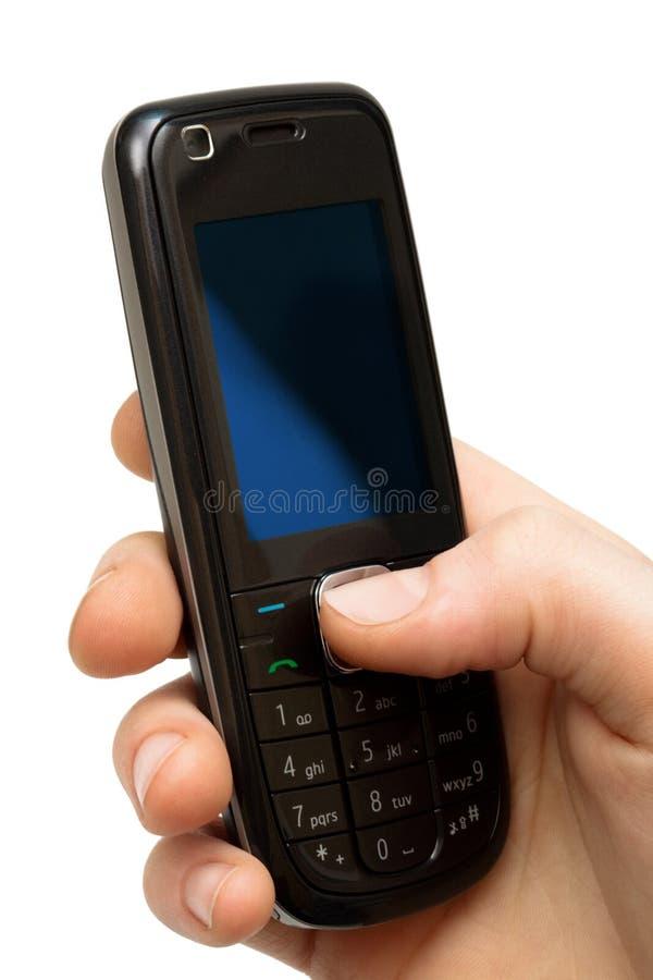 Telefono mobile in una mano fotografie stock libere da diritti