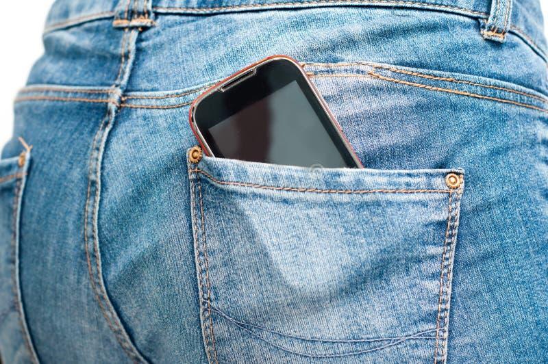Telefono nella tasca posteriore immagini stock libere da diritti