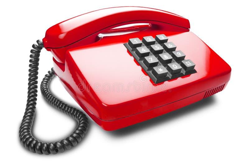 Telefono rosso della linea terrestre su fondo bianco isolato con ombra fotografie stock
