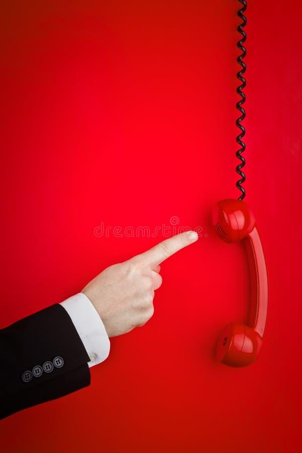 Telefono rosso fuori dall'amo fotografie stock libere da diritti