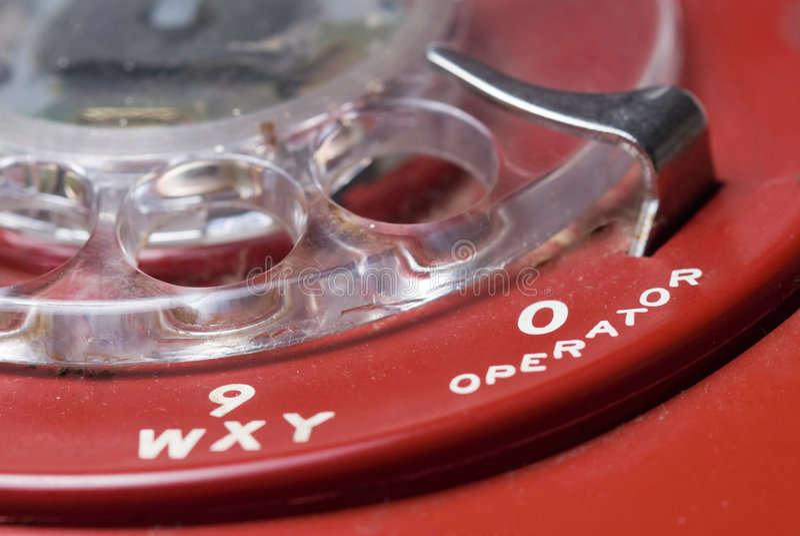 Telefono rotativo rosso fotografia stock libera da diritti