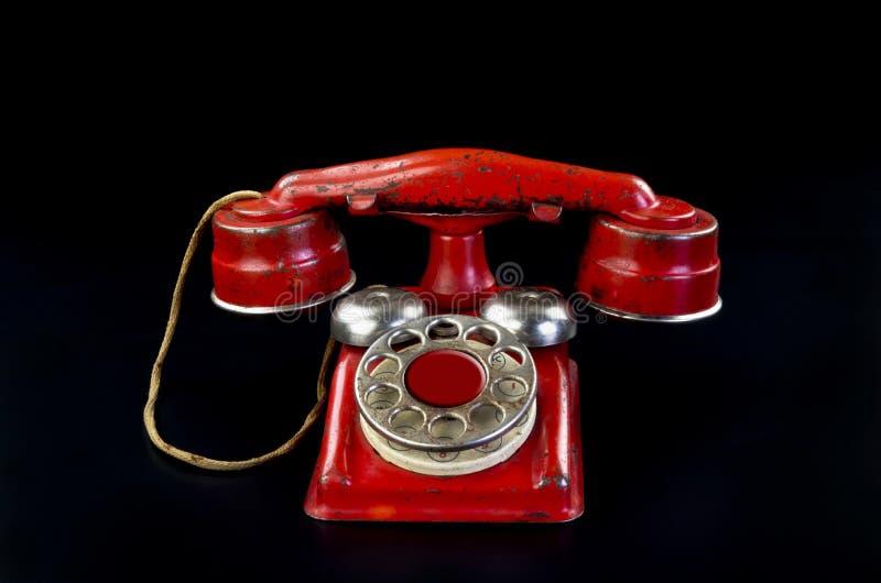 Telefono rotatorio rosso. immagini stock