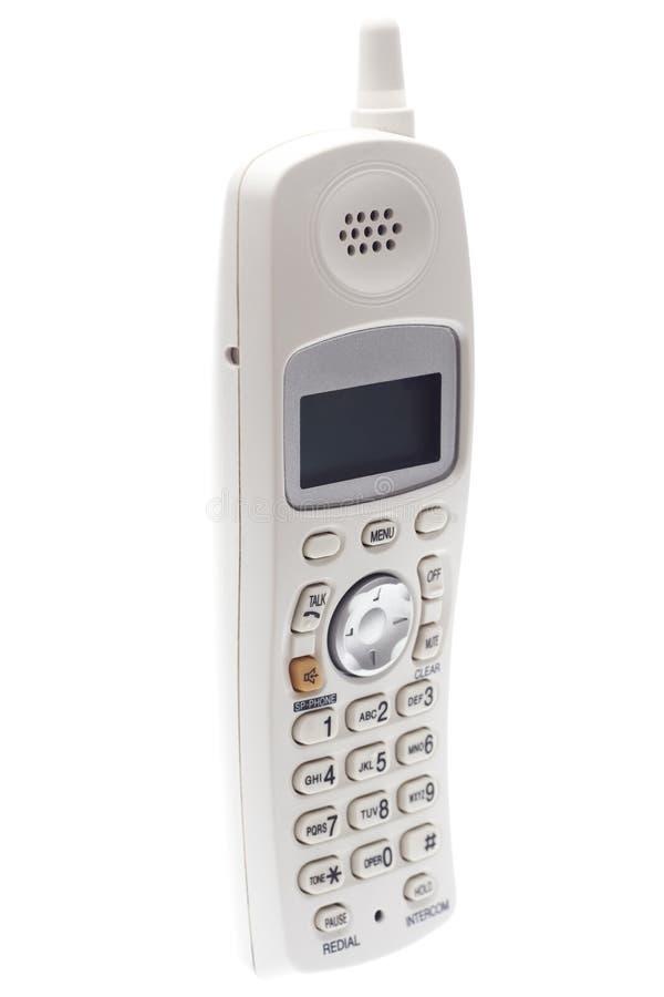 Telefono senza cordone bianco. Ad angolo fotografia stock libera da diritti